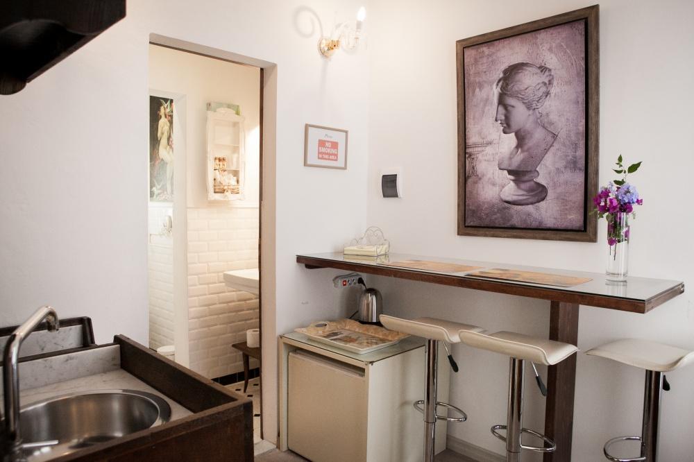 camera deluxe con giardino e piano cottura in villa storica al mare follonica